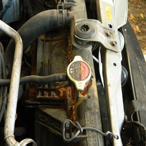 Замена антифриза Mazda Demio