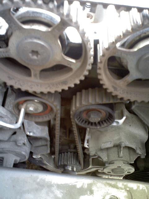снятие натяжного ролика двигателя Форд Фокус