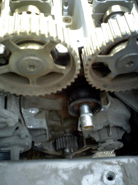 натяжной ролик ремня ГРМ двигателя Zeteс 1,8 л